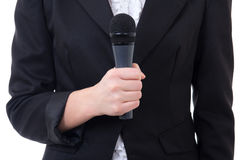 Black microphone in female journalist's hand Stock Photography