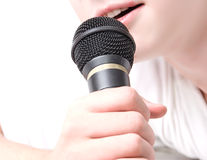 Black microphone in a hand Royalty Free Stock Images