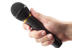 Black microphone in the hand Royalty Free Stock Photo