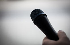 Black Microphone with Hand Royalty Free Stock Photography