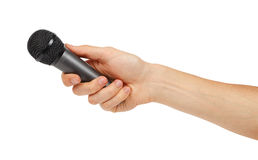 Black microphone in the hand Royalty Free Stock Images