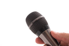 Black microphone in the man's hand Stock Photo