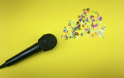 Microphone spreading colored letters royalty free stock photo