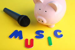 Black microphone. With piggybank and inscription Music stock photography
