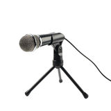 Black microphone on a rack isolated royalty free stock photos