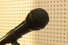 Black microphone in the studio for practicing vocals Stock Photos