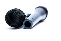 Black microphones on a white background Stock Photo