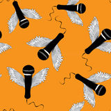 Black microphones with wings. Seamless pattern. Vector illustration on orange background. Hand drawn black microphones with wings. Seamless pattern. Vector stock illustration