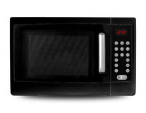 Black Microwave. Black digital microwave on an white background royalty free stock photos