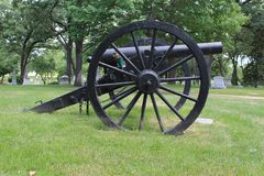 A Black Military Canon in a Cemetery Royalty Free Stock Photo
