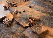 Black and milk chocolate, coffee, anise macro on a dark background Royalty Free Stock Image