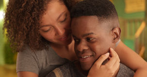 Black millennial couple embrace each other outside Stock Photos