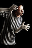 Black mime. Portrait of a female mime in sailor's striped vest Royalty Free Stock Photography