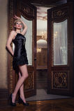 Black mini. Attractive blonde woman in an elegant black mini dress Royalty Free Stock Images
