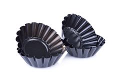 Black mini tart tins on white background Royalty Free Stock Photography