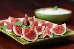 Black mission figs with nut and honey cheese Royalty Free Stock Photo