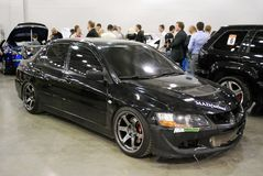 Black Mitsubishi Lancer Evolution VII in Crocus Expo 2012 Royalty Free Stock Images