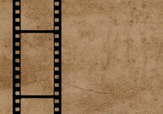 Black 35mm film strip with old background. Nice illustration of a black 35mm film strip with old background royalty free stock photography