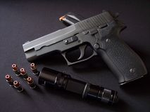 Black 9mm Semiautomatic pistol handgun with ammo and flashlight stock photography
