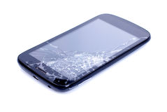 Black mobile phone with a broken screen on an isolated background. Black mobile phone with broken screen on an isolated background stock photo