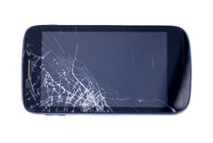 Black mobile phone with a broken screen on an isolated backgroun. Black mobile phone with broken screen on an isolated background royalty free stock image
