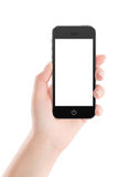 Black mobile smart phone with blank screen in female hand Stock Image