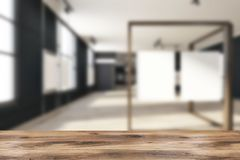 Black mock up poster gallery, art exhibition blur. Black brick poster gallery with a wooden floor and loft windows. Vertical empty posters hanging on glass and stock illustration