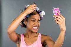 Black Model Applying Makeup stock photo
