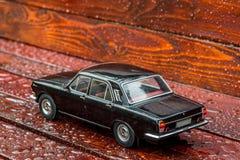 Black model limousine on mahagony boards Royalty Free Stock Photo