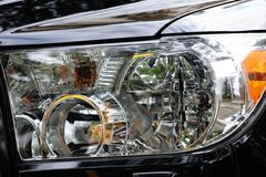 Black modern automobile headlight as background Royalty Free Stock Photos