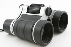 Black modern binoculars, laying flat Stock Images