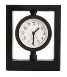 Black modern clock. Over white background Royalty Free Stock Photos