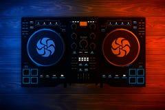 Black Modern DJ Set Turntable Mixer Equipment in Color Lights. 3. Black Modern DJ Set Turntable Mixer Equipment in Color Lights on a wooden table. 3d Rendering Royalty Free Stock Photography