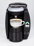 A black modern espresso coffee machine is making a coffee Stock Photo