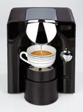 A black modern espresso coffee machine is making a coffee Royalty Free Stock Photography