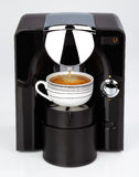 A black modern espresso coffee machine is making a coffee Royalty Free Stock Image