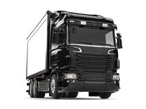 Black modern heavy transport truck. Isolated on white background Stock Photos