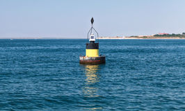 Black modern navigation buoy with yellow stripe Royalty Free Stock Image