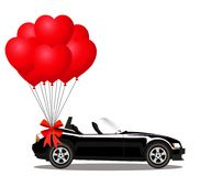 Black cabriolet car with bunch of red helium heart balloons. Black modern opened cartoon cabriolet car with bunch of red helium heart shaped balloons with Royalty Free Stock Images