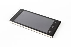 Black modern smartphone with blank screen lies on the surface, h Stock Photo