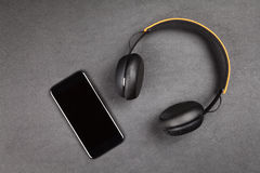 Black modern smartphone and headphones Royalty Free Stock Photography