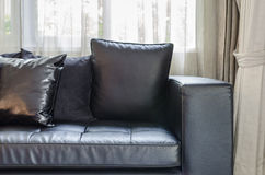 Black modern sofa in living room Royalty Free Stock Images