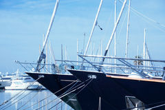Black modern yachts at sea port Stock Photos