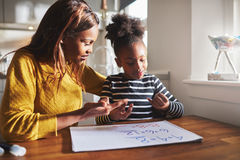 Black mom and child doing homework stock image