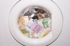Black money. Banknotes in washing machine Stock Photo