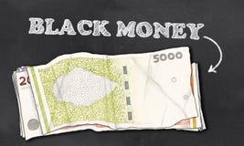 Black Money on Blackboard Stock Images