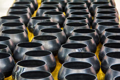 Black monk alms bowls. Black  monk& x27;s alms bowls on table in temple waiting for donation at Wat Maha Wanaram & x28;Wat Pa Yai& x29;,Ubonratchathani Province Stock Photography