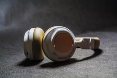 On black monophonic background lie big earphones for listening of music. Modern technologies and gadgets.n royalty free stock images
