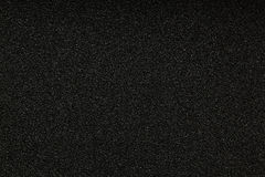 Black monotone grain texture. Glitter sand background Stock Images