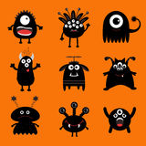 Black monster big set. Cute cartoon scary silhouette character. Baby collection. Orange background. Isolated. Happy Halloween card Royalty Free Stock Image